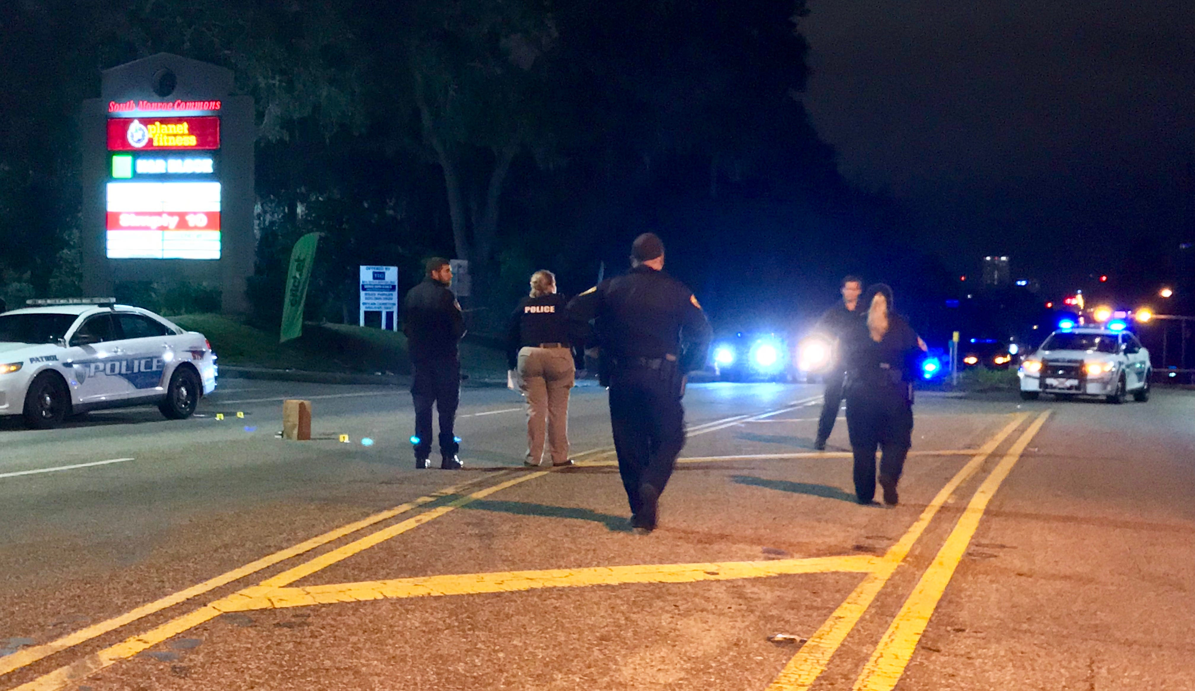 Tallahassee police respond to a shooting that injured three people early Sunday morning near a shopping center on South Monroe Street.
