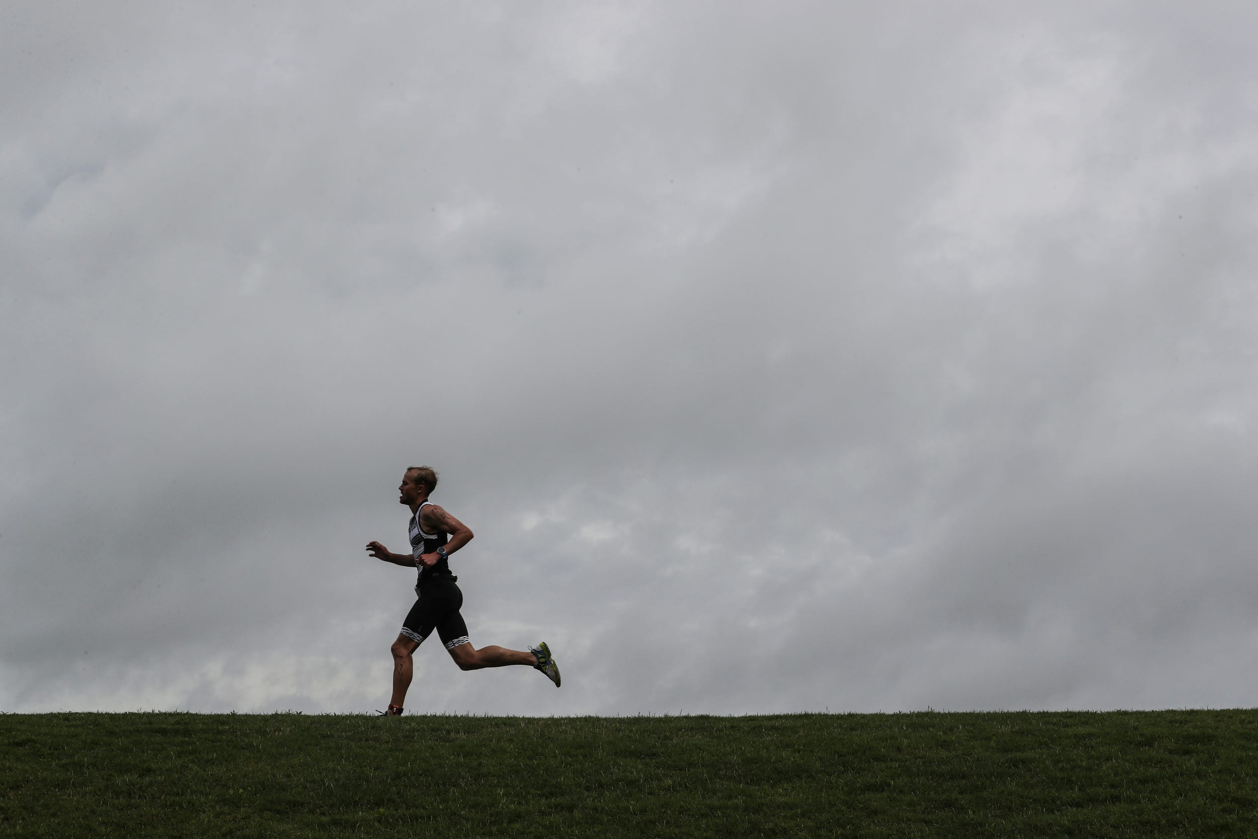 A runner pushes along the final stretch of the course during the 2019 Memphis in May triathlon at Edmund Orgill Park in Millington on Sunday, May 19, 2019. Jordan Green and Kirsten Sass were the winners of the annual triathlon.