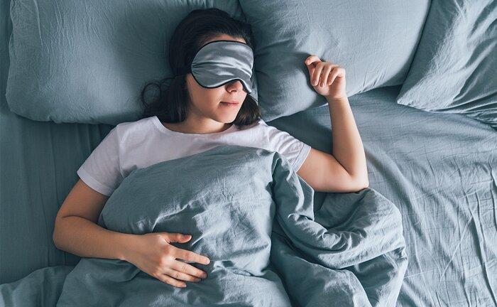 Sleeping with an eyeshade.